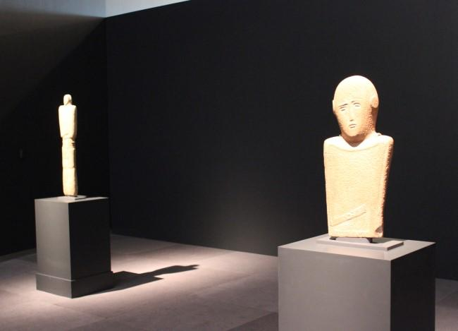 The first objects visitors will see are three illuminated stelae, including these.