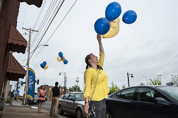 Conservatory student Haley Crane held fast to a small bunch of  balloons at the announced site of the Downtown Campus for the Arts south of the Kauffman Center.
