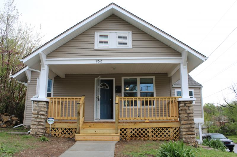 This house on Olive St. was rehabbed by Blue Hills Community Services.  It was completely redone. Neighbors had thought this house was going to be torn down. Helen Bryant is getting the house ready for an open house.