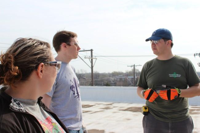 The USGBC and Historic Green have organized several work days, like this tuck pointing workshop attended on this day by Knoll (at right), and Tiffany Hoffman (at far left) and Kyle Rogler (center)