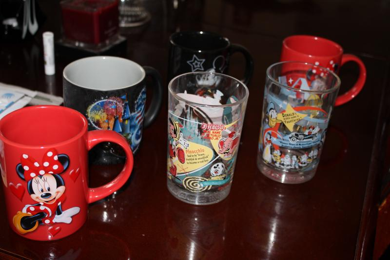 Disney memorabilia is on display throughout Walt Disney's former house in Kansas City. The home's current occupant, Roberta Long, keeps her collection of Disney mugs and glasses in her curio cabinet.