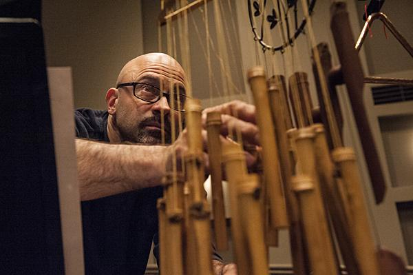 Percussionist Nick Petrella brushes his fingers through bamboo chimes to add to the ambiance.
