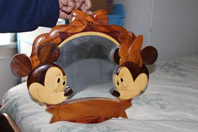 This vintage Disney mirror is one of the many Mickey Mouse-themed items Roberta Long's family has received from neighbors and community members over the years.