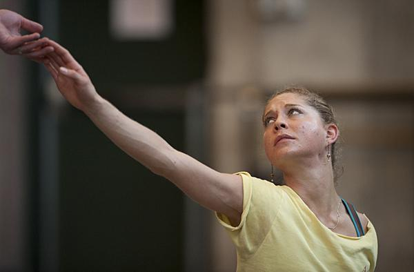 An expressive Wagner looks over her shoulder.