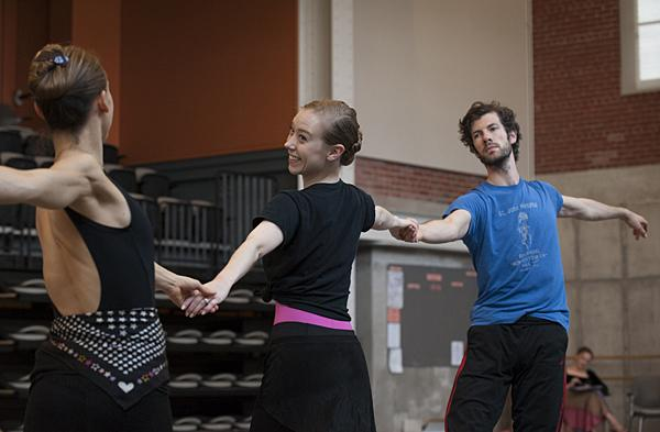 Dancers Tempe Ostergren (at left), Kaleena Burks, and Geoffrey Kropp glide through their steps with direction from Jordan.