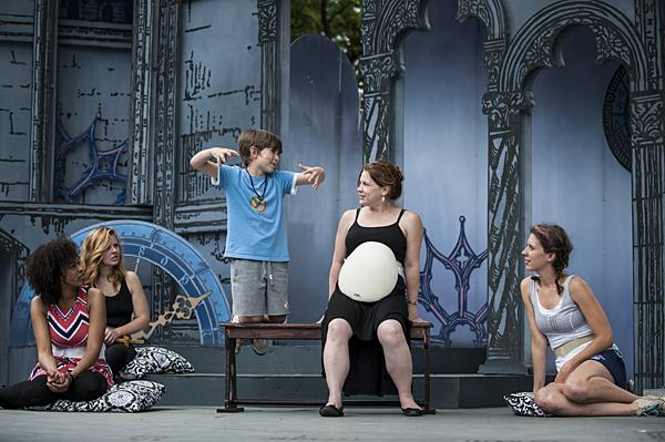 Mamillius, the young prince of Sicilia (Marek Burns), entertains his mother Queen Hermione (Cinnamon Schultz, wearing a pregancy pack) and her ladies in waiting.