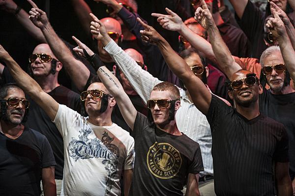 Chorus members sport sunglasses and sideburns in tribute to Elvis.