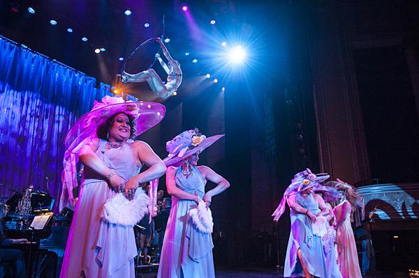 Chorus girls don outsized hats to dance to 'Pansies Everywhere.'