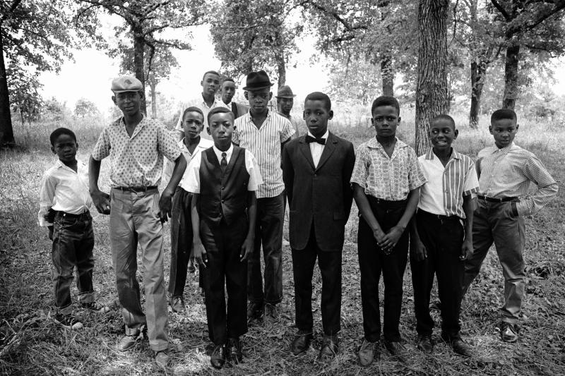 St.Paul's Missionary Baptist Church, summer 1964. Young men and boys from congregation in their Sunday best, stand in glade behind church.