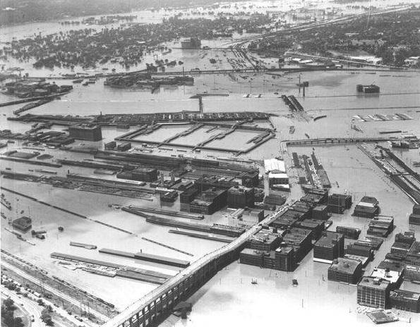 This 1951 aerial photo looking southwest over the 12th Street Bridge shows the extent of the flooding damage in the West Bottoms.