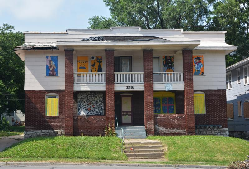 Members of the Historic Northeast community painted the boards of this abandoned building in 2011 to deter vandalism. The house is currently for sale.