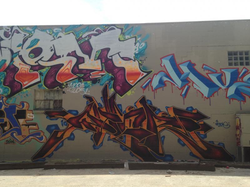 Gear's writing (bottom) on a wall on Southwest Boulevard.