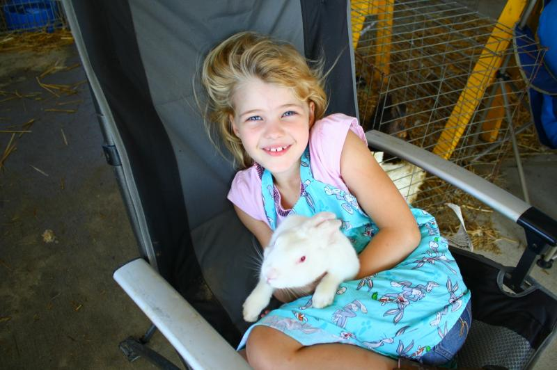 Allyson Billings relaxes with her pet rabbit.