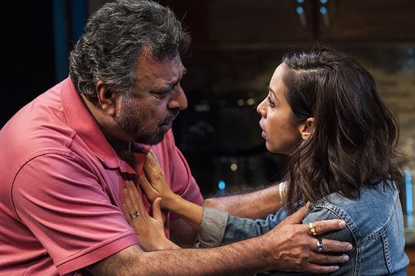 Afzal (Tony Mirrcandani) and his daughter Mahwish (Kat Nejat) try to decide what to do with the manuscript.