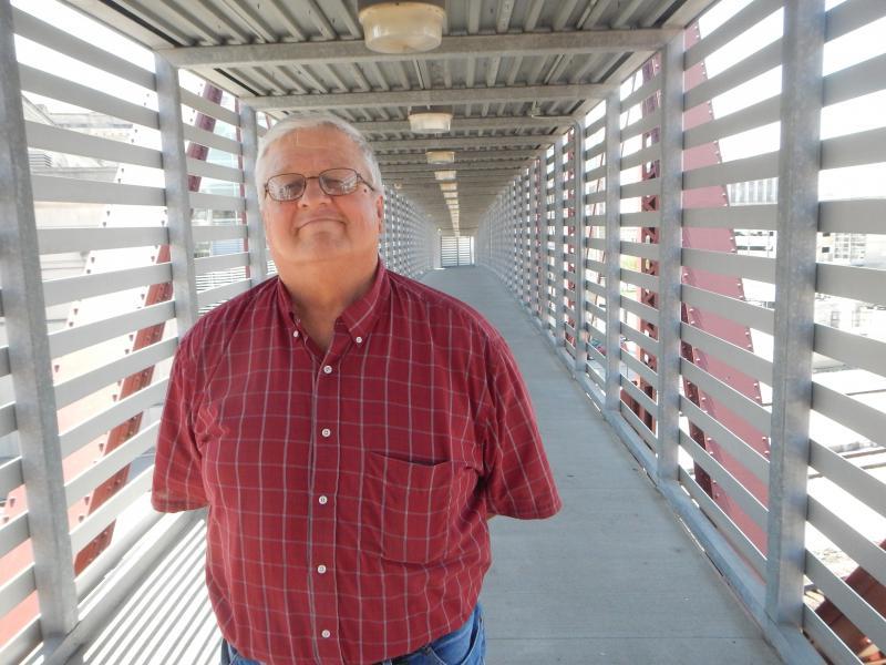 Rail hobbyist, Jeff Van Leuvan on the pedestrian bridge at Kansas City's Union Station.