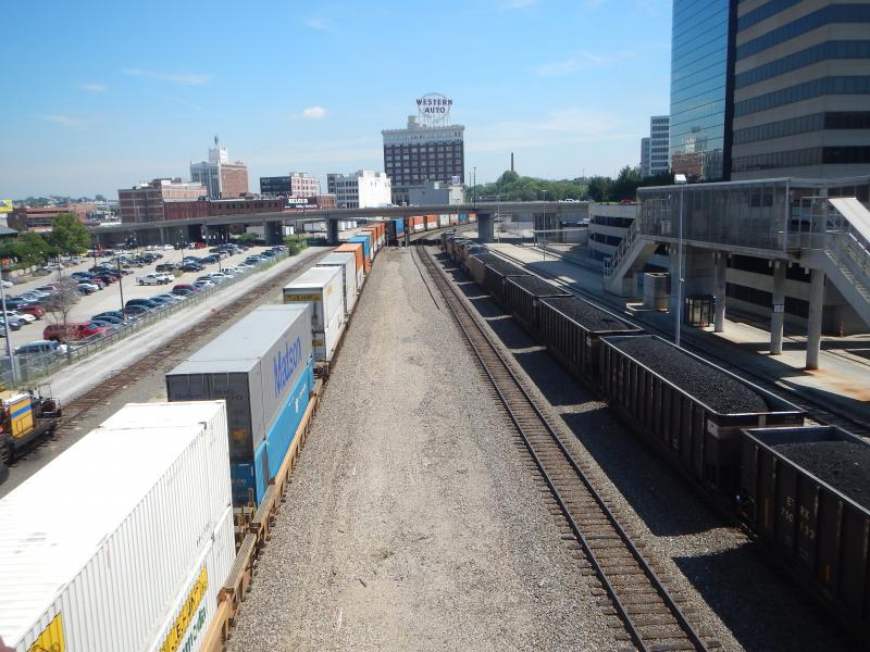 The view from Union Station's pedestrian bridge as two trains pass by.
