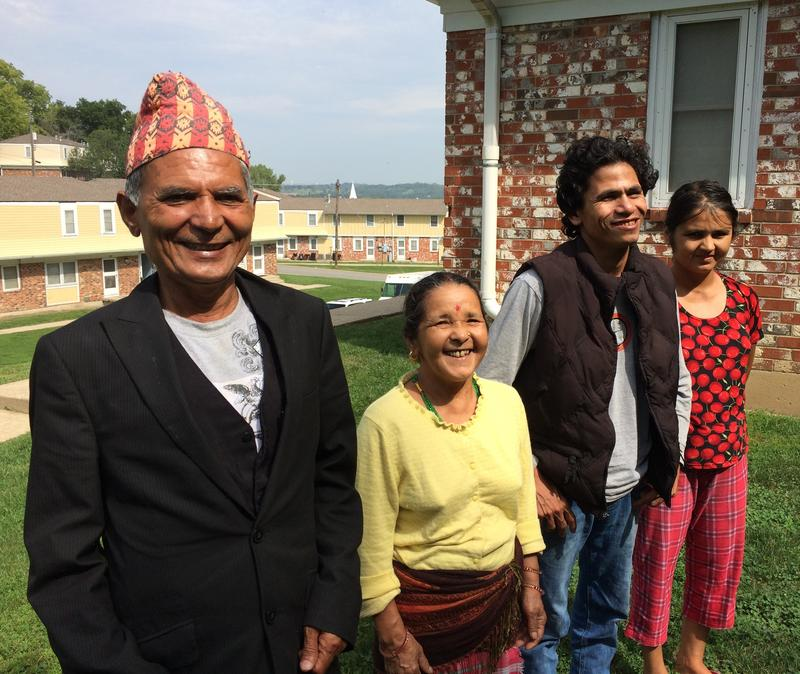 Palak and Durga Khadka with their son-in-law, Birkha, and daughter, Ganga (left to right) next to their home in Chalet Manor in Kansas City, Kan.