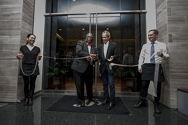 Nearly two years after a natural gas explosion and fire destroyed JJ's restaurant, Kansas City Mayor Sly James and owner Jimmy Frantze cut the ribbon at the restaurant's reopening ceremony in the Polsinelli Building in the West Plaza.