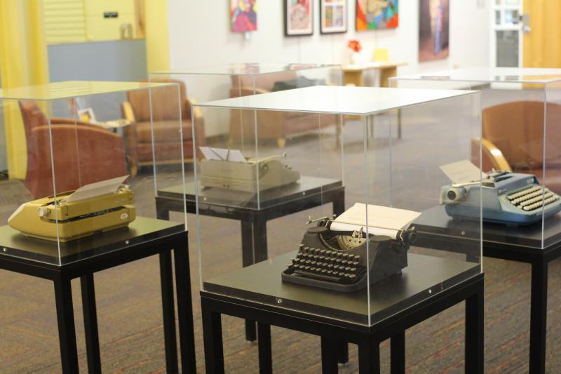 Artist Jordan Ashley Hocker's vintage typewriters are located in the center of the gallery at the Johnson County Resource Library.