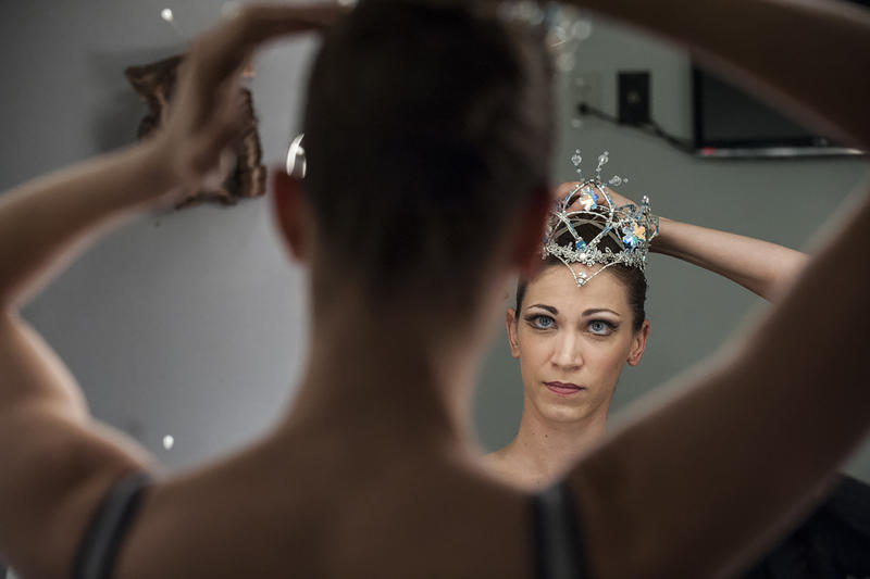 Snow Queen Angelina Sansone adjusts her crown in front of her dressing room mirror.
