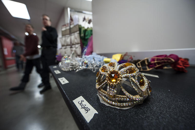 The hallways are aflutter with activity in preparation for the final dress rehearsal as Artistic Director Devon Carney passes a table laden with crowns.