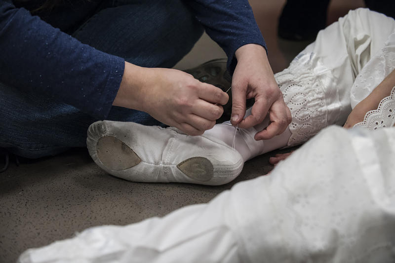 No task is too small for Jennifer Carroll, the costume supervisor at Kansas City Ballet. When Clara (Leah Reiter) needed a little help sewing her slippers, Carroll stepped in.