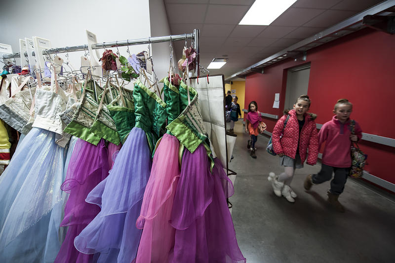 Young dancers make their way to their dressing rooms to prepare.