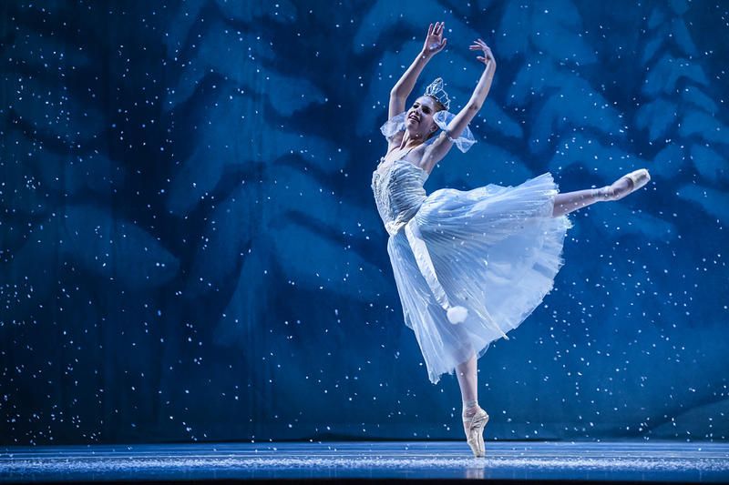 Snowflake Hannah Keene drifts across the stage in a swirl of snow.