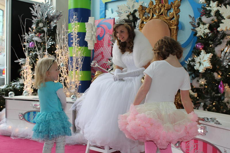 Lindsey Griffith, a Fairy Princess for 2014, visits with sisters Charlotte and Violet at Zona Rosa Shopping Center in the Northlands.