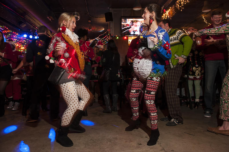 Courtney Bowles and Lauren Bowles hit the dance floor in their holiday outfits.