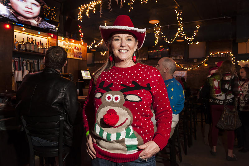 Wearing a Rudolf sweater lifted from her mother's closet, Liz Cahill topped her wardrobe off with a red felt cowboy hat.