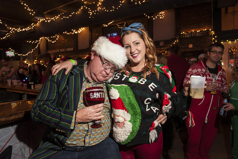 Thomas Lueckenhoff  and Haylee Morris share some holiday cheer at the bar.