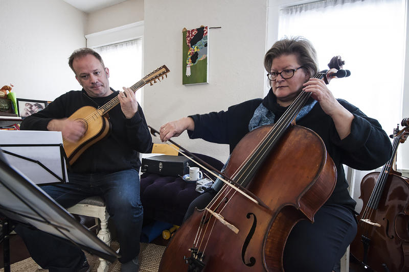 Bledsoe and Trilla Ray-Carter on baroque cello rehearse. Ray-Carter says she discovered 'The Darkest Midnight,' when preparing for a Celtic concert several years ago.