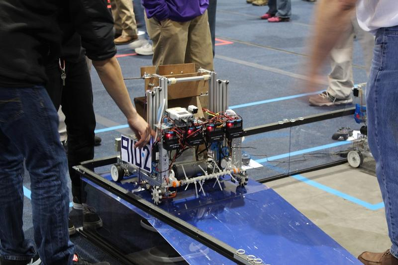 Olathe Northwest High School junior Nick Rodriguez makes a last minute check on his team's robot.