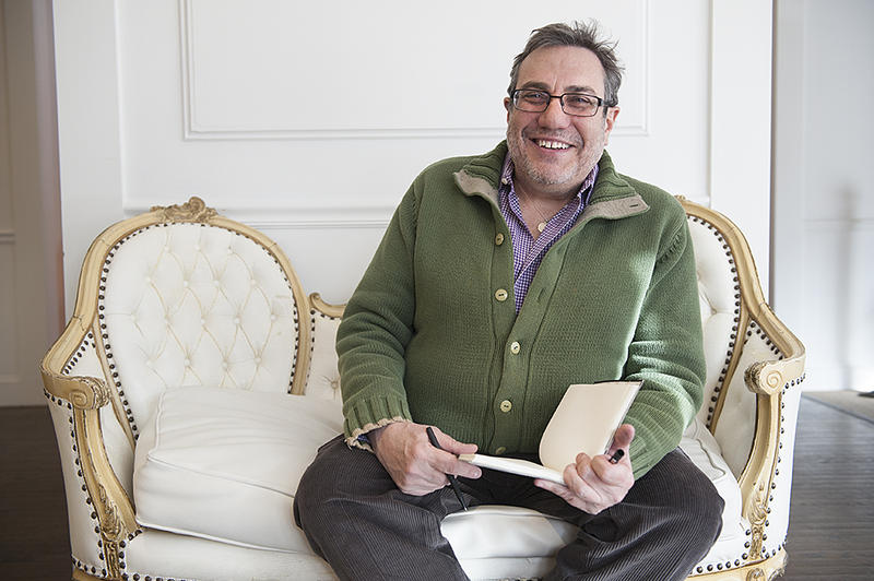 Charles Ferruzza relaxes on a sofa during a culinary outing at Natasha's Mulberry & Mott in Kansas City, Mo.