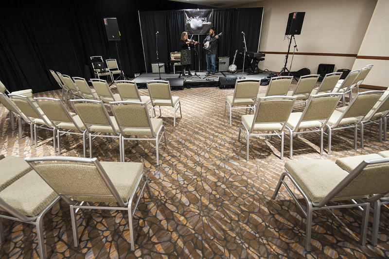 Empty chairs surround the stage as Ellis and Wyatt run through a snippet of 'Collard Greens' during a sound check before their music showcase.
