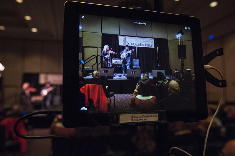 An iPad records Betse & Clarke performing at a Camp Faculty concert at the Sheraton.