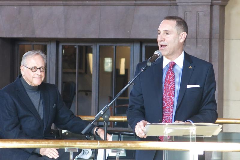 Union Station Vice Chairman Lee Derrough (left) and President & CEO George Guastello introduce the Gridiron Glory exhibit.