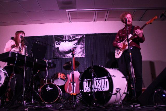 Playing four instruments between them, the husband-and-wife duo Black Bird Revue fills one of the Kansas City Music Collective's rooms with sound.