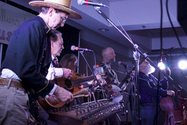 Lawrence's Alferd Packer Memorial String Band performs on the Music Fair stage at the Sheraton on Saturday night.