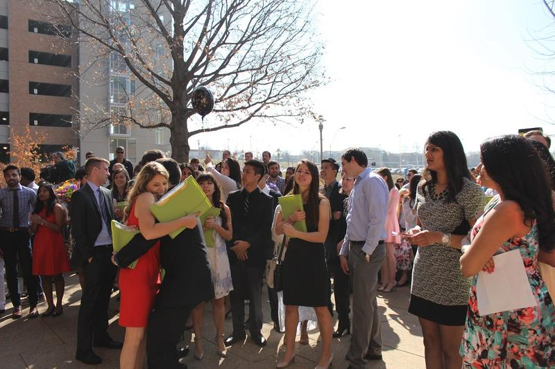 The new graduates clutched their green envelopes with their residency assignments tight as they congratulated each other.