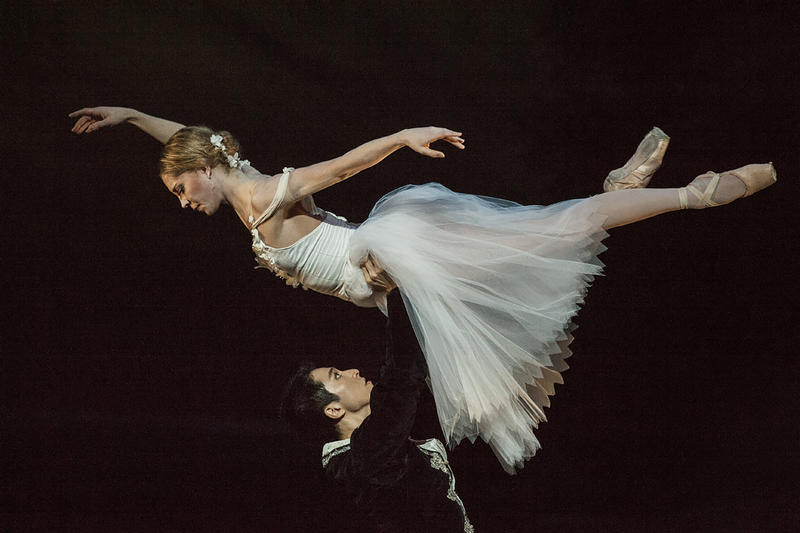 A ghostly Giselle (Molly Wagner) floats above Albrecht (Liang Fu) during a final dance together in 'Giselle.'
