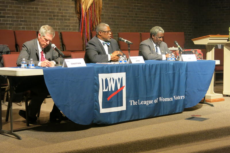 Transit advocate Clay Chastain, left, Mayor Sly James, and Vincent 'The General' Lee take questions at a League of Women Voters mayoral candidate forum.
