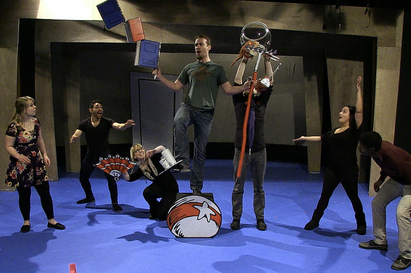 The Cat (Jake Walker), Thing 1 (Tony Pulford) and Thing 2 (Pancha Brown) stand on balls, balance teacups, and make a mess in the home of Boy (Donovan Woods) and Sally (Deanna Mazdra) and their Fish (Damian Blake).