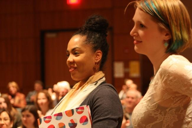 Johnson County librarians Angel Tucker (left) and Kate McNair listen to students read poetry at the Elementia launch party.