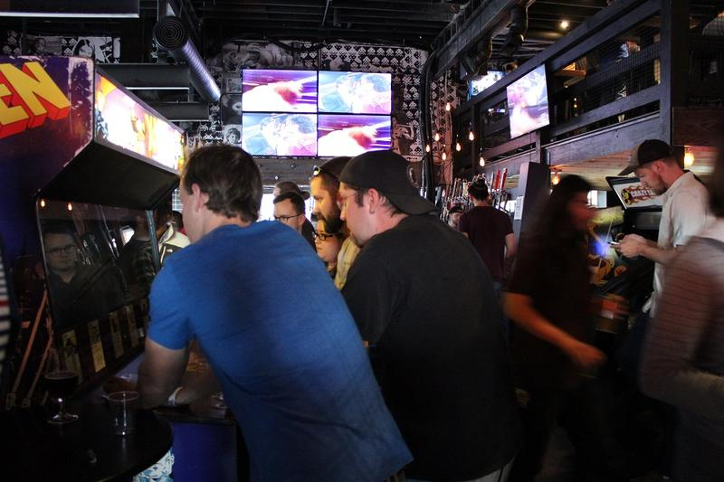 Hundreds packed into the old Hamburger Mary's building to play retro arcade games at the new Up-Down arcade bar last Friday.