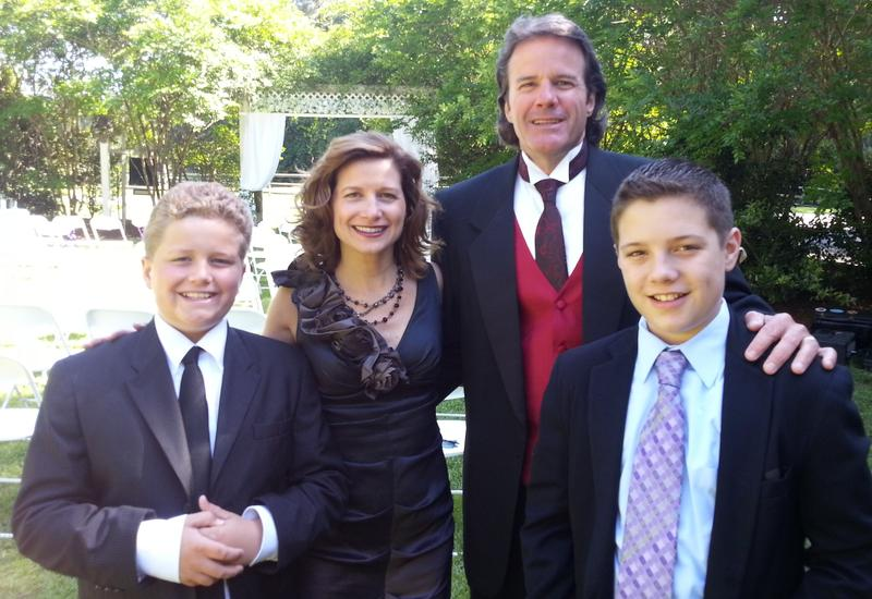 Mindy Corporon poses in a May 2013 family photo with her husband, Len Losen, and their sons, Lukas Losen and Reat Underwood (right). Reat was killed alongside his grandfather, William Corporon, outside the Jewish Community Center on April 13, 2014.