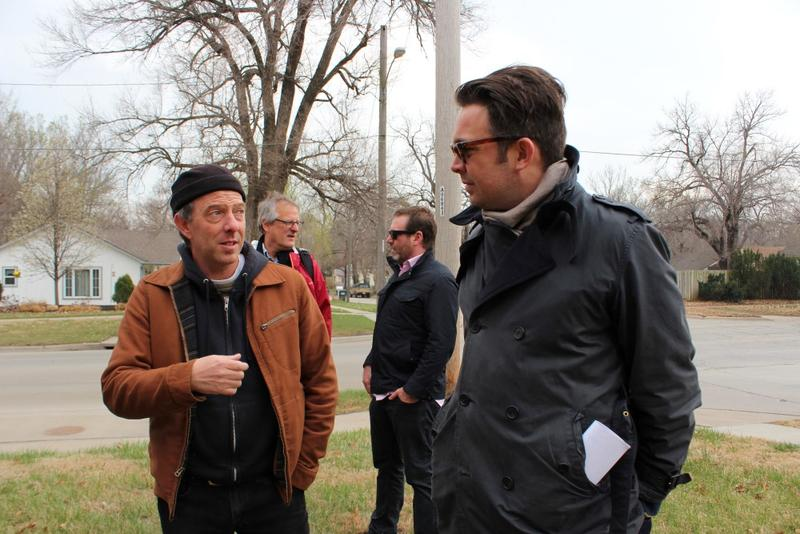 Artist Dave Loewenstein (at left), a member of the citizen advisory committee, talks to British artist Tristan Surtees of Sans Facon.