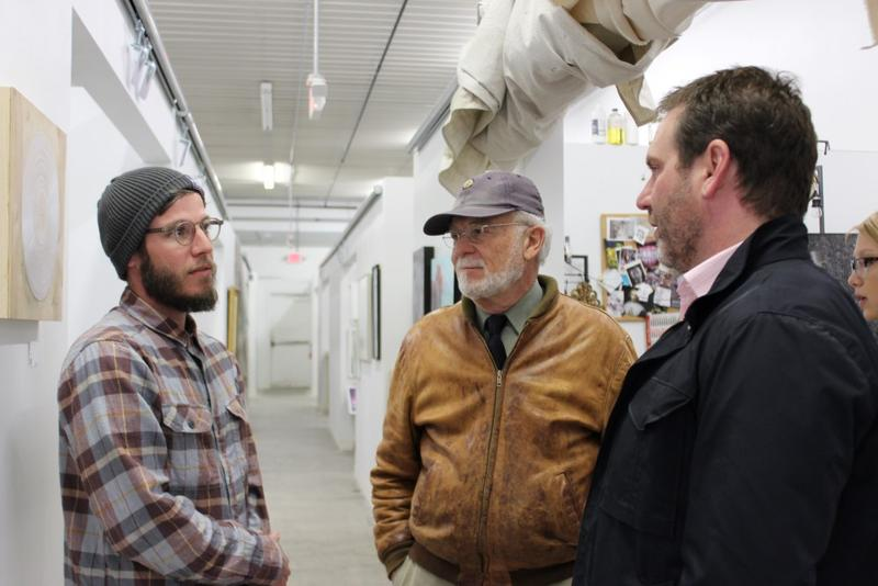 Artist Jeremy Morris (from left) talks to architectural historian Dennis Domer and el dorado principal Josh Shelton near his SeedCo studio.