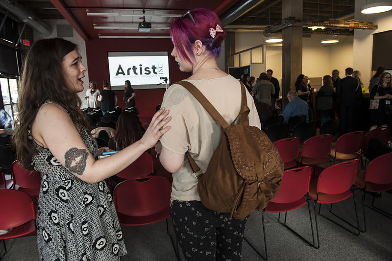 After seven weeks of Artist Inc. classes, artists begin to arrive for the final session, where they must each give a five-minute presentation about their work for an audience of their peers.